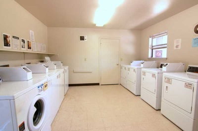 Photo of laundry room with multiple washers and dryers